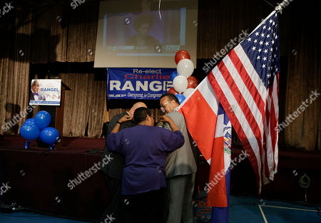 Supporters for Rep. Charlie Rangel, D-N.Y., watch election returns during a primary election night gathering, in New York. Rangel is seeking his 23rd term against opponent state Sen. Adriano Espaillat