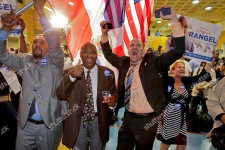 Supporters for Rep. Charlie Rangel, D-N.Y., react as they watch election returns during a primary election night gathering, in New York. Rangel is seeking his 23rd term against opponent state Sen. Adriano Espaillat