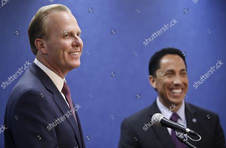 Kevin Faulconer, Todd Gloria San Diego mayor-elect Kevin Faulconer, left, and interim mayor Todd Gloria enjoy a laugh while holding a news conference, in San Diego. Faulconer won the city's special election Tuesday to replace former mayor Bob Filner who resigned
