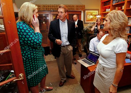 Jeff Flake, Sarah Morgan, Cheryl Flake Arizona Republican Senate candidate and current U.S. Rep. Jeff Flake, R-Ariz., center, talks with campaign manager Sarah Morgan, left, with his wife, Cheryl, right, at a primary election night party, at his home in Mesa, Ariz. Early polling humbers have Flake ahead of his challenger, Wil Cardon,in his effort to fill retiring Sen. Jon Kyl's, R-Ariz, seat