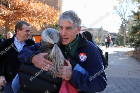 Mark Udall Sen. Mark Udall, D-Colo., accompanied by Sen. Michael Bennet, D-Colo., hugs a supporter during a visit to the University of Colorado in Boulder, Colo., on Election Day