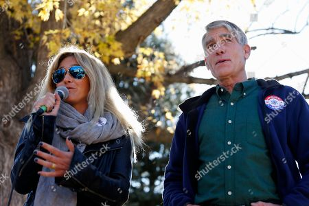 Mark Udall, Gretchen Bleiler Sen. Mark Udall, D-Colo., right, listens as Olympic snowboarder Gretchen Bleiler speaks to students during a visit to the University of Colorado in Boulder, Colo., on Election Day