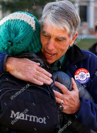Mark Udall Sen. Mark Udall, D-Colo. hugs a supporter during a visit to the University of Colorado in Boulder, Colo., Election Day