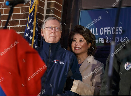 """Mitch McConnell, Elaine Chao Senate Minority Leader Mitch McConnell, R-Ky., and his wife, former Labor Secretary Elaine Chao, listen as Pineville, Ky., native Jimmy Rose sings """"Coal Keeps the Lights On,"""" during a rally at the Scott County Courthouse in Georgetown Ky., Saturday night, . The results of the closely watched Kentucky contest will be crucial in the midterm election that could shift the balance of power in Congress"""