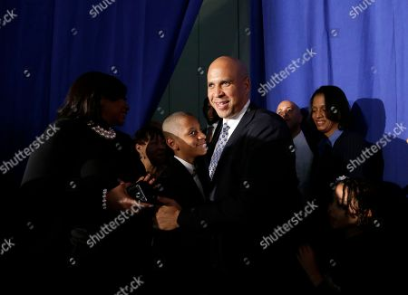 Cory Booker Sen. Cory Booker, D-N.J., center, arrives at an election night victory gathering, in Newark, N.J. Booker, who won a special election last year for the seat that was vacated by the death of Democratic U.S. Sen. Frank Lautenberg, went up against Republican challenger Jeff Bell
