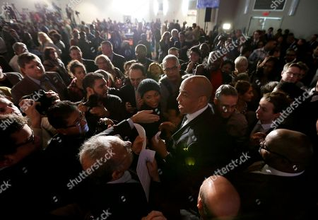 Cory Booker Sen. Cory Booker, D-N.J., center, is mobbed by supporters during an election night victory gathering, in Newark, N.J. Booker, who won a special election last year for the seat that was vacated by the death of Sen. Frank Lautenberg, went up against Republican challenger Jeff Bell