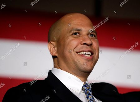 Cory Booker Sen. Cory Booker, D-N.J. addresses supporters during an election night victory gathering, in Newark, N.J. Booker, who won a special election last year for the seat that was vacated by the death of Sen. Frank Lautenberg, went up against Republican challenger Jeff Bell