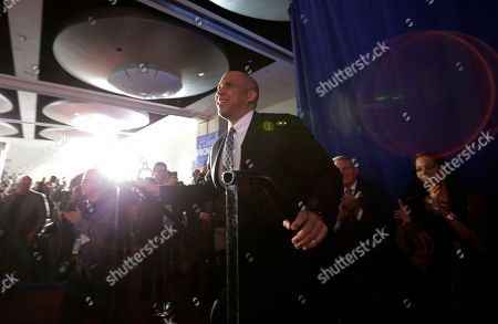 Cory Booker Sen. Cory Booker, D-N.J., arrives to an election night victory gathering, in Newark, N.J. Booker, who won a special election last year for the seat that was vacated by the death of Democratic U.S. Sen. Frank Lautenberg, went up against Republican challenger Jeff Bell