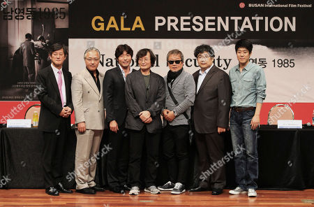 "Lee Yong-kwan, Lee Kyeong-yeong, Park Weon-sang, Chung Ji-young, Myung Gye-nam, Seo Dong-soo, Kim Jung-gi From left, Lee Yong-kwan, festival director of the Busan International Film Festival, South Korean actor Lee Kyeong-yeong, actor Park Weon-sang, director Chung Ji-young, actor Myung Gye-nam, actor Seo Dong-soo and actor Kim Jung-gi pose together druing a press conference to promote their movie ""National Security"" at the Busan International Film Festival in Busan, South Korea, . The film based on the memoir of a democracy activist who was tortured in the 1980s by South Korea's military rulers is provoking discussion about the country's not-so-distant authoritarian past and the influence it will have on this year's presidential election"