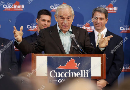 Ken Cuccinelli, Ron Paul Republican gubernatorial candidate, Virginia Attorney General Ken Cuccinelli, right, listens to former U.S. Rep. Ron Paul, center, during a rally in Richmond, Va., . Cuccinelli faces Democrat Terry McAuliffe in Tuesday's election