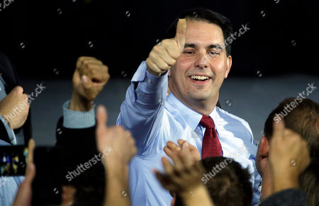 Scott Walker Wisconsin Republican Gov. Scott Walker gives a thumbs-up after speaking at his campaign party, in West Allis, Wis. Walker defeated Democratic gubernatorial challenger Mary Burke. Walker said in an interview, that he remains committed to lowering property taxes next year as he promised in his re-election campaign, even though the state faces a projected $2.2 billion state budget shortfall that will likely result in spending cuts and other money-saving moves