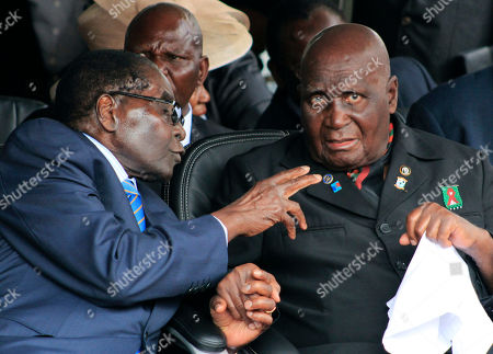 Zimbabwean president, Robert Mugabe, left, and former Zambian president, Kenneth Kaunda, attend the inauguration ceremony of the Patriotic Front's Edgar Lungu, in Lusaka . Lungu the candidate from the ruling Patriotic Front, has won Zambia's presidential election called after President Michael Sata died in October, the acting chief justice announced late Saturday