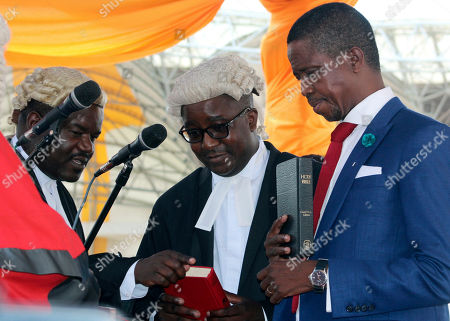 Edgar Lungu The Patriotic Front's Edgar Lungu, right, is sworn in as president at an inauguration ceremony in Lusaka . Lungu the candidate from the ruling Patriotic Front, has won Zambia's presidential election called after President Michael Sata died in October, the acting chief justice announced late Saturday