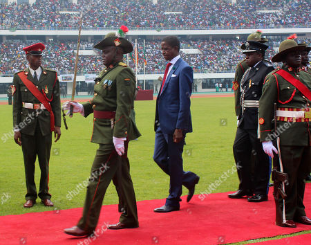 Stock Picture of Edgar Lungu The Patriotic Front's Edgar Lungu, centre, inspects a guard of honor after being sworn in as president at an inauguration ceremony, in Lusaka after he won the president elections. Lungu the candidate from the ruling Patriotic Front, has won Zambia's presidential election called after President Michael Sata died in October, the acting chief justice announced late Saturday