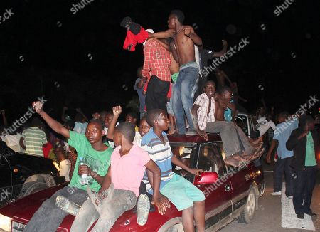 Supporters of the Patriotic Front celebrate after an announcement that their presidential candidate, Edgar Lungu won the presidential elections in Lusaka, Zambia, . Lungu narrowly defeated his rival Hakainde Hichilema in the contest to succeed Michael Sata, who died in office in October at 77