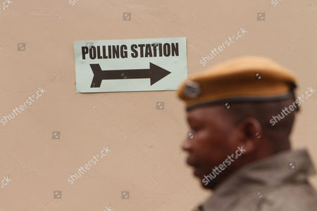 A solider is seen at a polling station on presidential election day in Lusaka, . Zambians are voting to choose a new leader following the death of Michael Sata, 77, who died Oct. 2014, in a London hospital following a long illness, after serving as President of the Southern African country since 2011