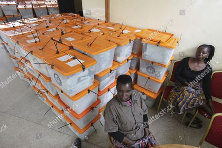 Polling agents guard ballot boxes as counting of ballot papers continues a day after presidential elections in Lusaka, Zambia, Wednesday, Jan, 21, 2015. Candidates vying to replace Zambia's late President Michael Sata have cast their ballots along with thousands of other voters in Tuesday's presidential election