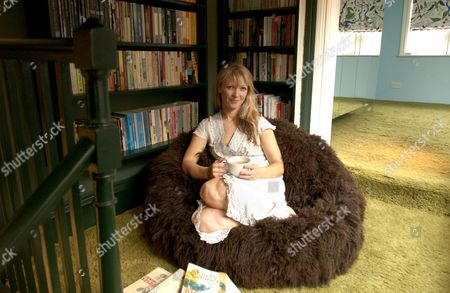 Naomi Cleaver for 'My Favorite Room', a book corner between the top of the stairs and an attic bedroom in her London EC1 studio and home - 25 Apr 2006