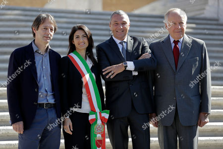 From left, Rome's culture commissioner Luca Bergamo, Rome's mayor Virginia Raggi, Jean-Christophe Babin, CEO of Bulgari luxury goods company, and Nicola Bulgari, great-grandson of the Bulgari founder, pose for photographers prior to the start a press conference to present the reopening on the world-famous Spanish Steps at the end of 10 months of restoration works financed by Bulgari, in Rome