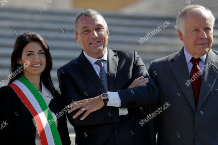 Virginia Raggi, Jean-Christophe Babin, Nicola Bulgari From left; Rome's mayor Virginia Raggi, left, Jean-Christophe Babin, CEO of Bulgari jewelry house, and Nicola Bulgari, great-grandson of the Bulgari founder, pose for photographers at the world-famous Spanish Steps ahead of a press conference to present the reopening of the site at the end of a 10-month restoration in which Bulgari jewelry house participated, in Rome,. The Spanish Steps will open again to the public on Friday