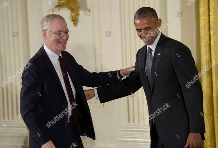 Barack Obama, Ron Chernow President Barack Obama shares a laugh with author Ron Chernow before presenting him with the 2015 National Humanities Medal during a ceremony in the East Room of the White House in Washington