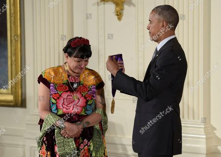 Barack Obama, Sandra Cisneros President Barack Obama presents author Sandra Cisneros with the 2015 National Medal of Arts during a ceremony in the East Room of the White House in Washington