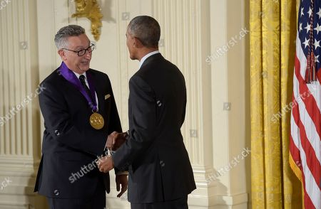Barack Obama, Moises Kaufman President Barack Obama shakes hands with director and playwright, Moises Kaufman after presenting him with the 2015 National Medal of Arts during a ceremony in the East Room of the White House in Washington
