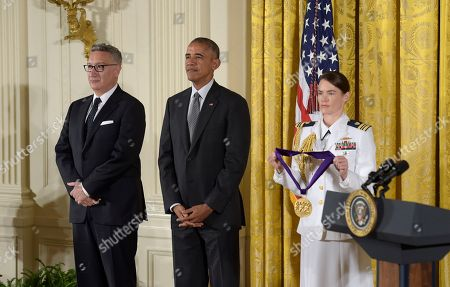Barack Obama, Moises Kaufman President Barack Obama listens as the citation is read for director and playwright, Moises Kaufman, left, during a ceremony to present him with the 2015 National Medal of Arts in the East Room of the White House in Washington