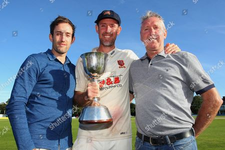 Stock Image of David Masters of Essex (C), brother Daniel (L) and father Kevin with the Division Two Championship Trophy during Kent CCC vs Essex CCC, Specsavers County Championship Division 2 Cricket at the St Lawrence Ground on 23rd September 2016