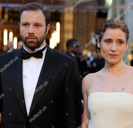 """Giorgos Lanthimos, left, director and writer of """"Dogtooth"""" and Aggeliki Papoulia, right, arrives before the 83rd Academy Awards, in the Hollywood section of Los Angeles"""