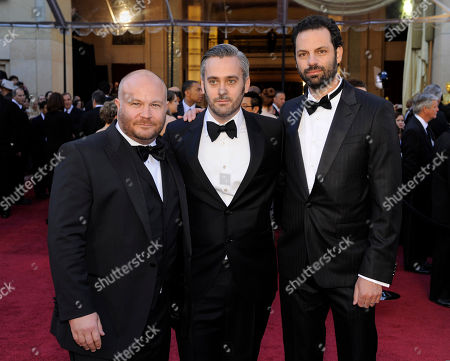 """Gareth Unwin, Iain Canning, Emile Sherman Gareth Unwin, far left, Iain Canning, center, and Emile Sherman, producers of the nominated film """"The King's Speech"""" arrive before the 83rd Academy Awards, in the Hollywood section of Los Angeles"""