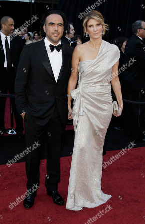 Stock Picture of Alejandro Gonzalez Inarritu, Maria Hagerman Gonzales Director Alejandro Gonzalez Inarritu, left, and his wife Maria Hagerman Gonzales arrive before the 83rd Academy Awards, in the Hollywood section of Los Angeles