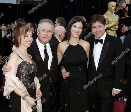 Alan Menken, Glenn Slater Songwriter Alan Menken, second from left, lyricist Glenn Slater, far right, and their guests arrive before the 83rd Academy Awards, in the Hollywood section of Los Angeles