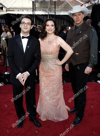 Producers Josh Fox, left, and Trish Adlesic, center, arrive before the 83rd Academy Awards, in the Hollywood section of Los Angeles