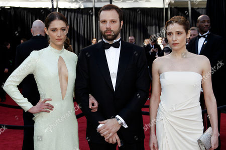 Giorgos Lanthimos, Aggeliki Papoulia Writer and director Giorgos Lanthimos, center, actress Aggeliki Papoulia, right, and a guest arrive before the 83rd Academy Awards, in the Hollywood section of Los Angeles