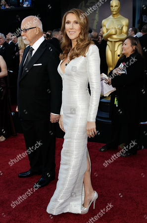 Celine Dion;Rene Angelil Singer Celine Dion, right, arrives with husband and manager Rene Angelil before the 83rd Academy Awards, in the Hollywood section of Los Angeles