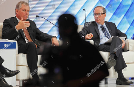 Doug Oberhelman, Andy Serwer Doug Oberhelman, chairman and CEO of Caterpillar, Inc., left, speaks as moderator Andy Serwer, Managing Editor of Fortune looks, at the Asia-Pacific Economic Cooperation summit Friday in Honolulu