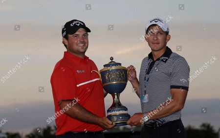 Patrick Reed, Kessler Karain Patrick Reed, left, and his caddie Kessler Karain hold The Gene Sarazen Cup after winning the Cadillac Championship golf tournament, in Doral, Fla