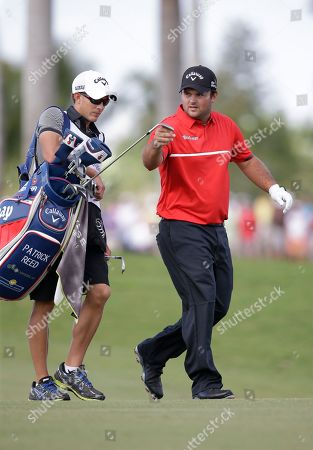 Patrick Reed, Kessler Karain Patrick Reed and his caddie Kessler Karain walk the eight fairway during the final round of the Cadillac Championship golf tournament, in Doral, Fla