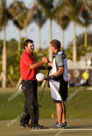 Patrick Reed, Kessler Karain Patrick Reed, left, shakes hands with caddie Kessler Karain after winning the Cadillac Championship golf tournament, in Doral, Fla