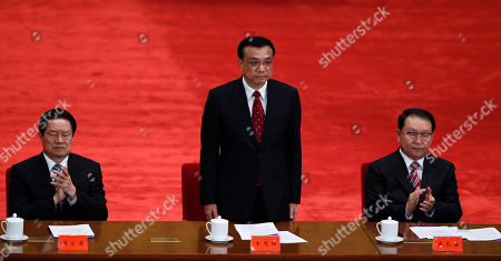Li Keqiang, Zhou Yongkang, Li Changchun Chinese vice Premier Li Keqiang, center, stands up while Zhou Yongkang, left, and Li Changchun, right, both Communist Party Politburo Standing Committee members, clap at a conference to celebrate the 90th anniversary of the founding of Chinese Communist Youth League at the Great Hall of the People in Beijing, China. Xi Jinping, China's vice president, has not been seen in public since Sept. 1, fueling speculation that he suffered a health crisis that forced him to cancel meetings with Hillary Clinton and others. Much attention will likely turn to Executive Vice Premier Li Keqiang, who many had picked as Hu Jintao's preferred successor before Xi emerged in late 2007 as a choice more acceptable to the party's factions