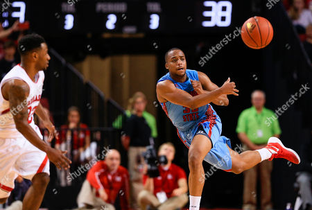 Stock Image of Todd Hughes, Benny Parker Delaware State's Todd Hughes (35) passes the ball as Nebraska's Benny Parker (32) watches, during the second half of an NCAA college basketball game in Lincoln, Neb., . Nebraska won 75-60