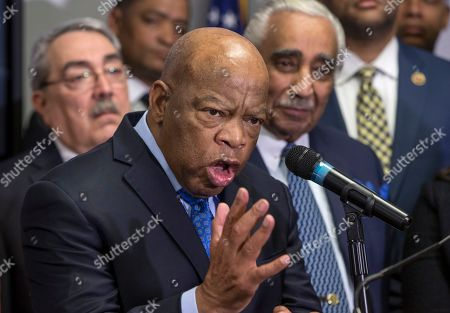 John Lewis, G.K. Butterfield, Charles B. Rangel Rep. John Lewis, D-Ga., a leader of the civil rights movement, is flanked by Rep. G.K. Butterfield, D-N.C., left, and Rep. Charles B. Rangel, D-N.Y., right, as he joins the Congressional Black Caucus Political Action Committee in endorsing Hillary Clinton as prominent African-American Democrats rush to her aid ahead of the Feb. 27 Democratic primary in South Carolina, on Capitol Hill in Washington, . Rep. Gregory W. Meeks, D-N.Y., chairman of the Congressional Black Caucus Political Action Committee, said that Clinton has been a long term partner who understands the racial divide