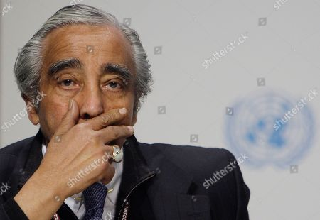 U.S. congressman Charles B. Rangel gestures as he joins Nancy Pelosi, speaker of the U.S. House of Representatives, during a briefing at the climate summit in Copenhagen, Denmark, . U.S. Secretary of State Hillary Clinton announced that the United States is prepared to join other rich countries in raising $100 billion in yearly climate financing for poor countries by 2020
