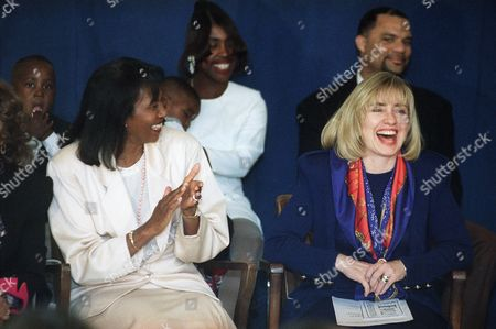 First lady Hillary Clinton laughs at a joke from the audience during a visit to Triangle Christian Family Preservation Network in South Central Los Angeles, . Clinton gave a short speech and met with parents and children who are served by the program. At left is Supervisor Yvonne Brathwaite Burke, chair of the Los Angeles County Board of Supervisors