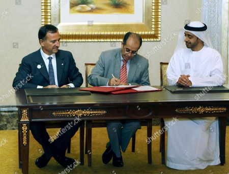 Stock Image of From left to right, Italian Minister of Foreign Affairs Franco Frattini, National Transitional Council leader Mahmoud Jebril of Libya and Sheik Abdullah bin Zayed, UAE foreign minister, sign an agreement during the third meeting of Contact Group on Libya in Abu Dhabi, United Arab Emirates