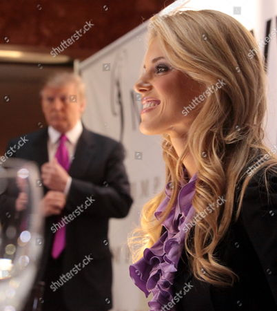 Donald Trump, left, and Miss California USA, Carrie Prejean, arrive for a news conference in New York, . Trump, who owns the Miss USA pageant, says Prejean can retain her Miss California USA crown after she caused a stir expressing opposition to gay marriage and posing in racy photographs