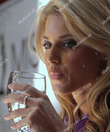Miss California USA, Carrie Prejean, sips from a glass as she listens during a press conference in New York, . Donald Trump, who owns the Miss USA pageant, says Prejean can retain her Miss California USA crown after she caused a stir expressing opposition to gay marriage and posing in risque photographs