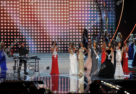 Miss USA 2013 From left, DJ Paul 'Pauly D' DelVecchio performs as the top six contestants pose on stage during the Miss USA 2013 pageant, in Las Vegas
