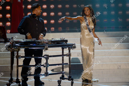 Miss USA 2013 From left, DJ Paul 'Pauly D' DelVecchio performs as Miss South Carolina Megan Tyler Pinckney walks on stage during the Miss USA 2013 pageant, in Las Vegas